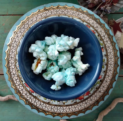llama party blue popcorn in small bowl