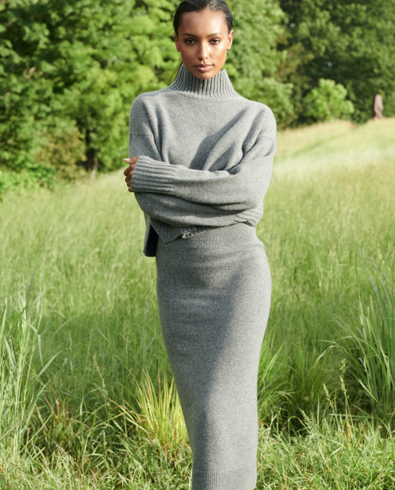 Jasmine Tookes poses in a grey knit set for NAKEDCASHMERE NAKED in October 2021 campaign. Photo: David Lipman