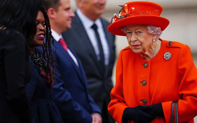 Queen Elizabeth wore an orange coat with a matching hat, accessorising with the Nizam of Hyderabad Rose brooch