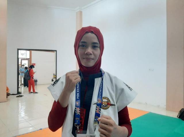 Atlet Tarung Derajat Kalbar, Nurhayati Persembahkan Emas PON Untuk Sang Suami.lelemuku.com.jpg