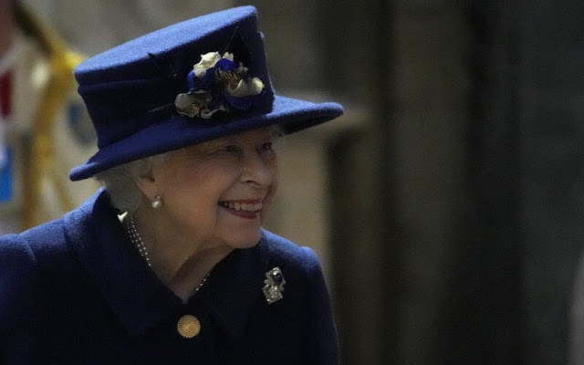 The Queen wore a navy blue coat, with a patterned dress. Queen Mary's Russian sapphire and diamond brooch