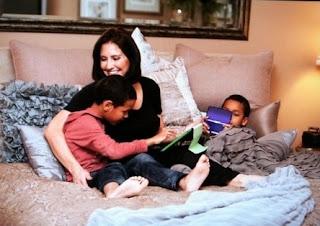 Robinson's wife Heather Lufkins with their children