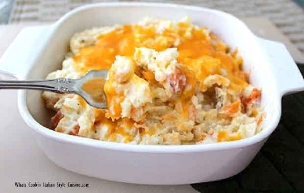 melted cheese topped potatoes and carrots