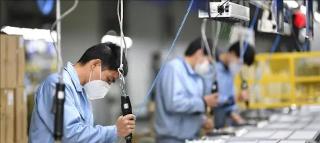 Production workers at a Skyworth factory in Guangzhou, capital of Guangdong province, China. Photo: THX