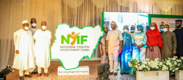 """Alt: = """"photo showing Nigeria Youths Investment Fund logo and group of officials of Ministry of Youth and Sports Development"""""""