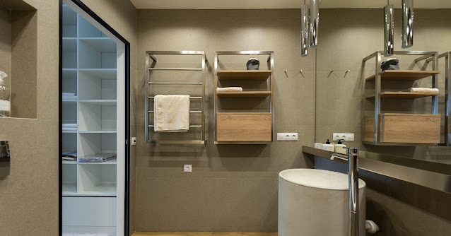 Large bathroom with a towel warming rack.