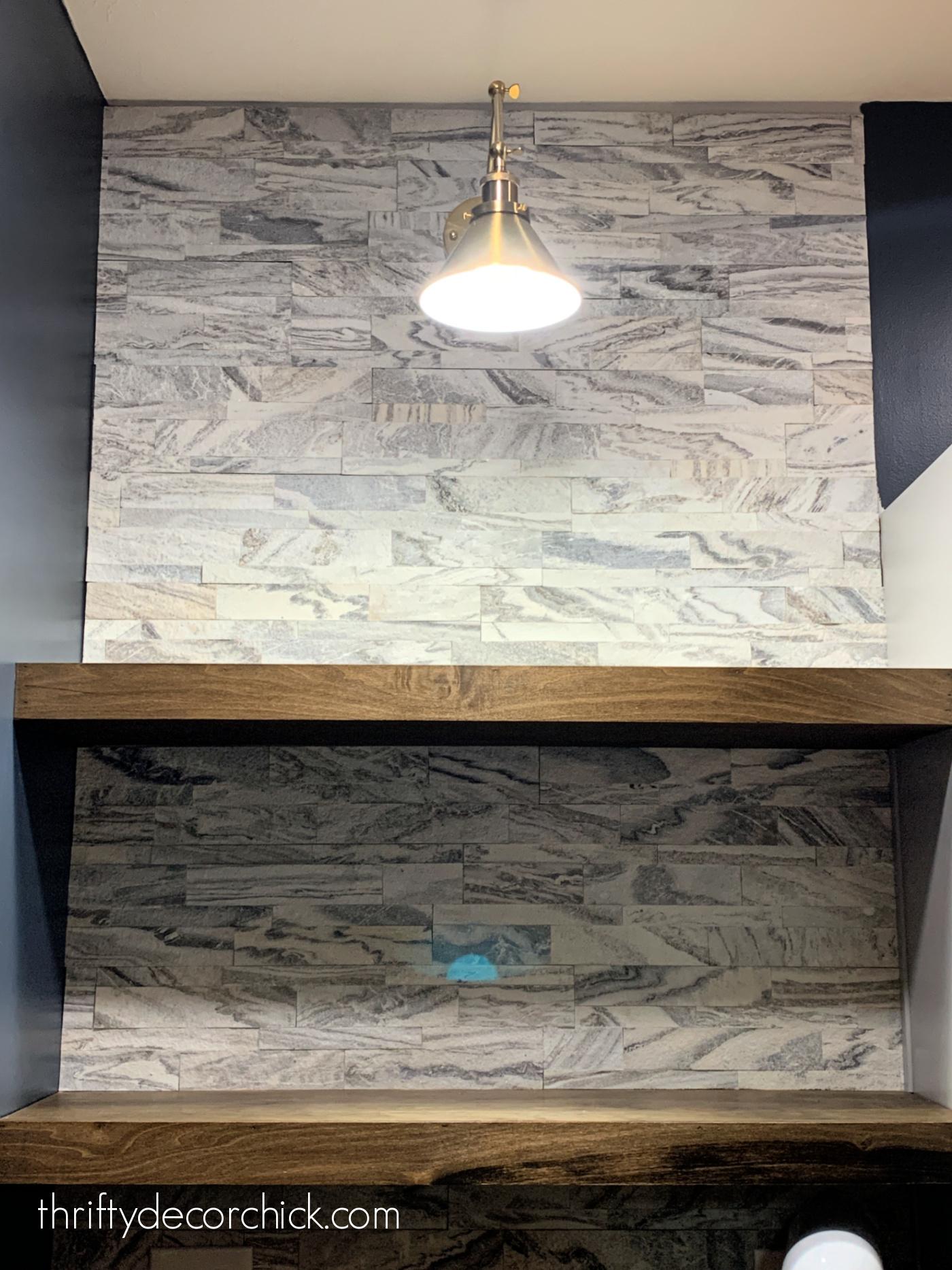 white gray marble backsplash with wood shelves