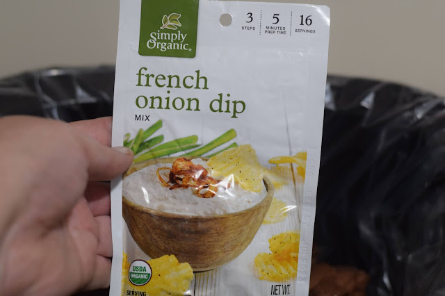 A packet of the vegan french onion dip mix going into the slow cooker.