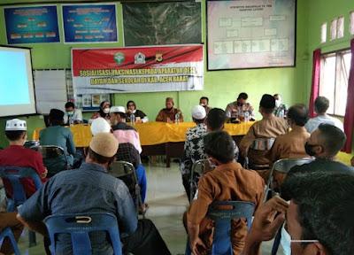 Danposramil 06/Bubon Hadiri Acara Sosialisasi Vaksinasi Di Aula Kantor Camat Bubon
