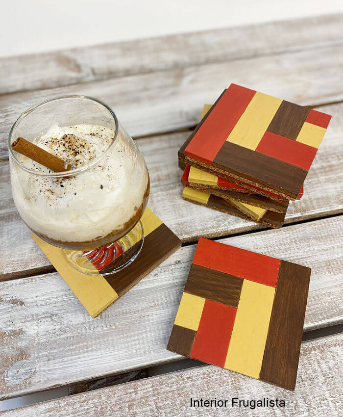 DIY instructions for how to recycle rectangular wooden blocks into unique wood tile mosaic drink coasters in pretty warm colors for fall decorating.