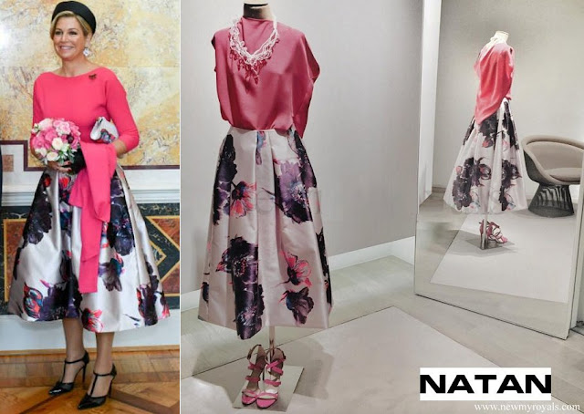 Queen Maxima wore a fuchsia blouse and floral print midi skirt from Natan
