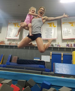 Jessie Graff posing for picture with a kid