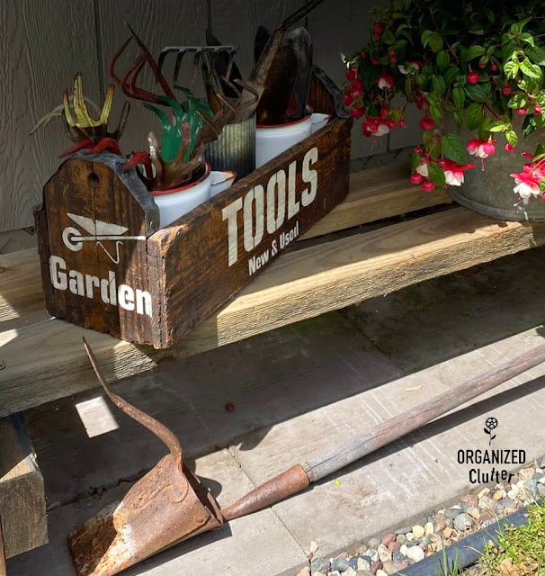 Photo of a garden tools stenciled toolbox.