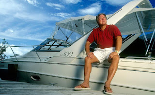Rhonda Rookmaaker's husband Johnson posing for picture with luxurious boat