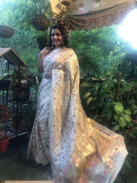 Banarasi ektara soft silk saree with multicolor meena work on a cream and gold base.
