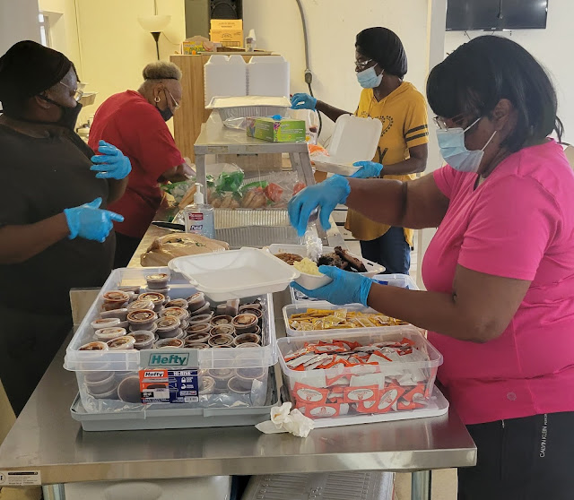 The Coopers serving BBQ at Luke AME Church in West Augustine for the Pinehurst and San Sebastian Cemeteries Restoration Day
