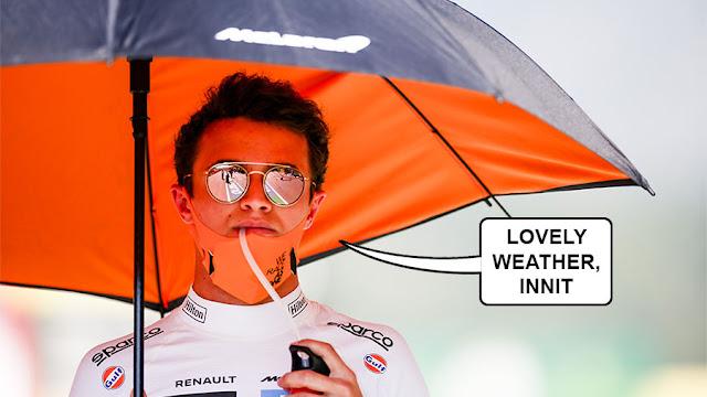 "Lando Norris under an umbrella saying ""lovely weather, innit"""
