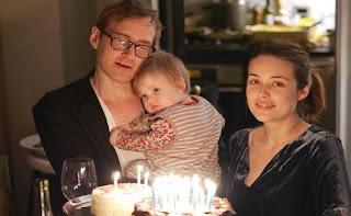 Dan Estabrook with his partner Megan Boone & their daughter