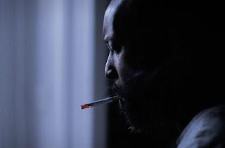 Exposure 36 - Man smoking a cigarette