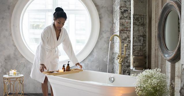 Woman preparing to take a hot bath.