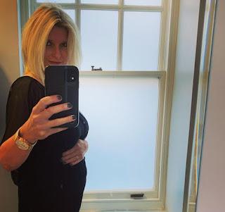 Sarah Stirk clicking selfie showing baby bump
