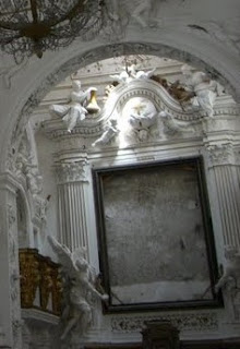 The empty frame above the altar,  pictured soon after the theft