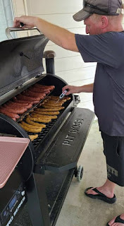 Army Maj. Scott Richardson at home grilling sausages to add to meals for crews restoring power after Hurricane Ida. (Photo courtesy of Army Maj. Scott Richardson)