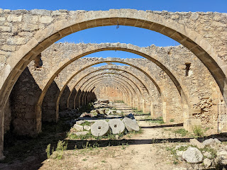 Arches of an abandoned olive oil mill of Monastery Agios Georgios, Karydi.