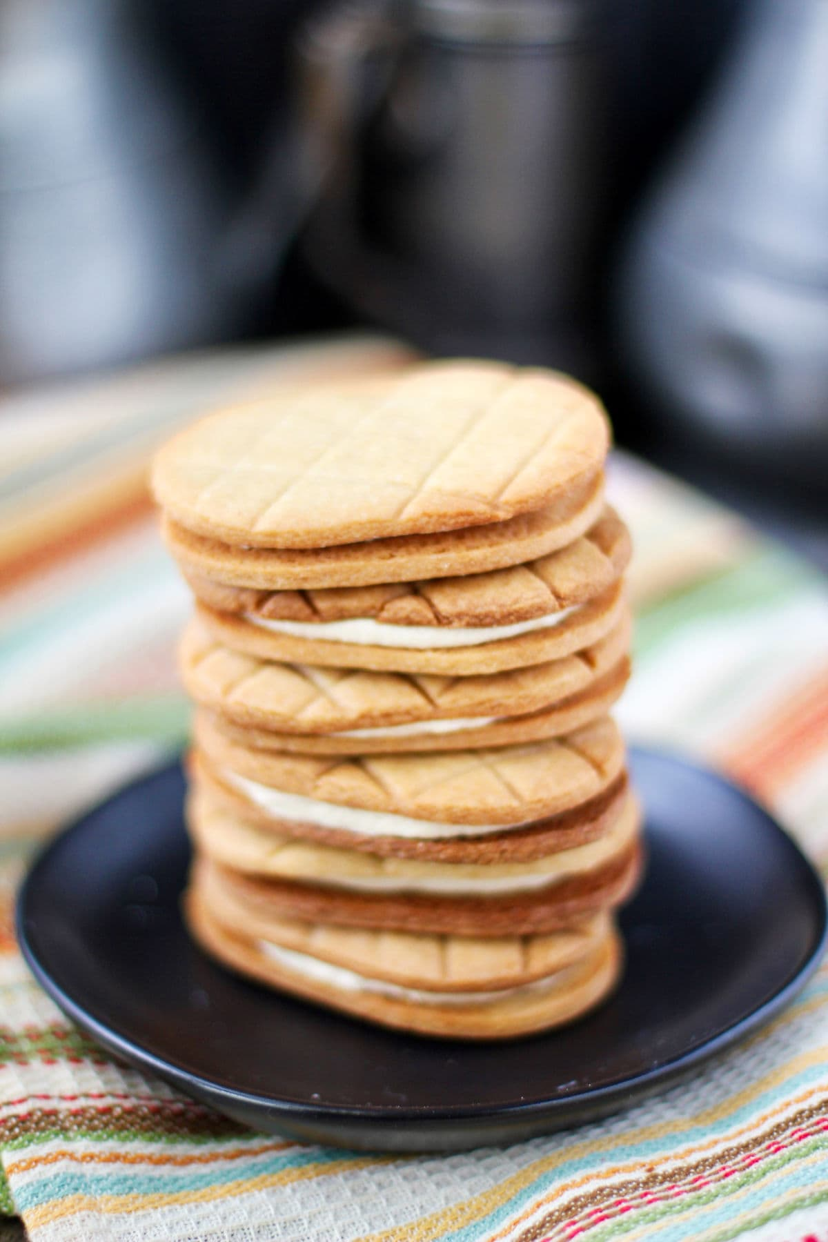 Homemade Nutter Butter cookies stacked.