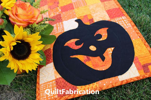 black pumpkin silhouette on orange fabrics