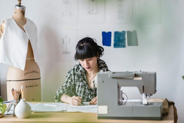 woman sketching at sewing machine - bamboo as eco-clothing