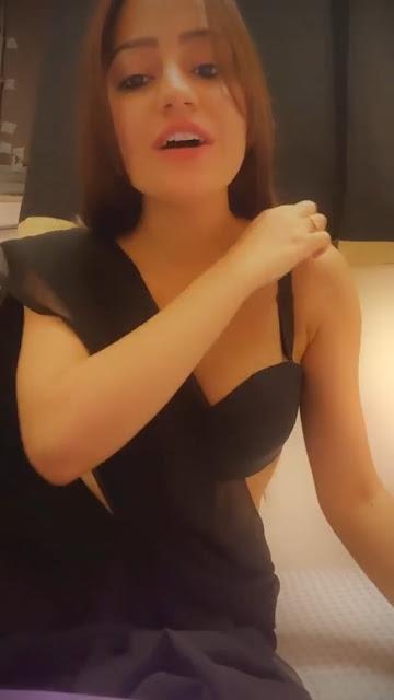 Symran K looks stunning in a sheer black saree Navel Queens