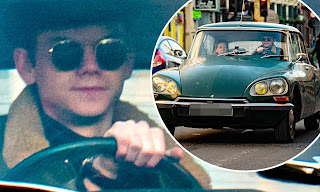 Thomas Brodie Sangster driving classic car with his mother