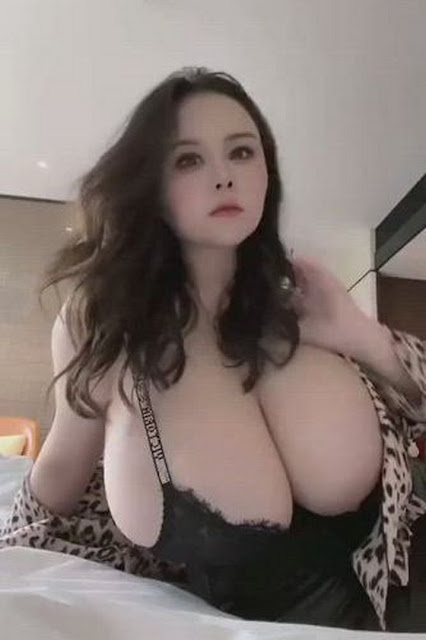 curvy Asian girl with huge tits
