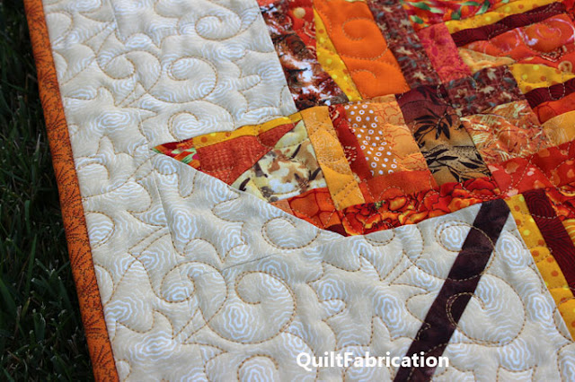 gold quilting on a maple leaf quilt