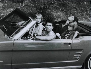 Riley's mom Mare in a car along with her co-actors