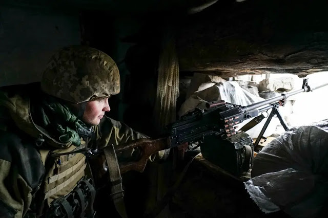 A Ukrainian soldier looks over a position near the front line with Russia-backed separatists in Shyrokyne, eastern Ukraine in November 2018. Photo: AP