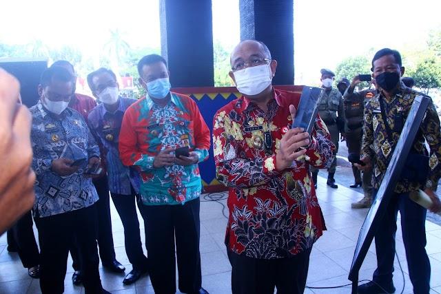 Pemerintah Kabupaten Lampung Utara Luncurkan Scan QR Code Aplikasi Peduli Lindungi dan gelar Vaksinasi Massal Dosis Kedua di Lingkungan Pemerintah Kabupaten Lampung Utara