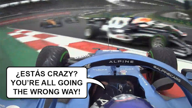 """A spun-round Alonso in his Alpine facing oncoming cars, saying """"¿Estás crazy? You're all going the wrong way!"""""""
