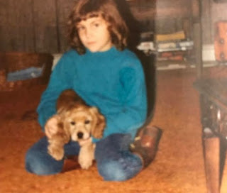 Childhood picture of Krystal Ball with a dog