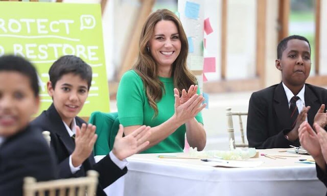 Kate Middleton wore a green Allie woolcrepe coat by Erdem, and Kelly green short sleeve knit sweater by Zara