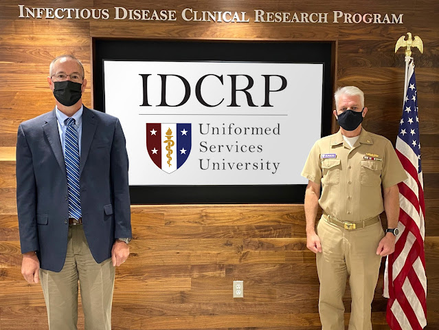 Navy Capt. (Dr.) Tim Burgess (right), USU's IDCRP director, and Dr. Brian Agan (left), IDCRP deputy science director are photographed at USU after receiving recognition for their part in the award winning EPICC COVID-19 Cohort Team. (Photo courtesy of IDCRP)