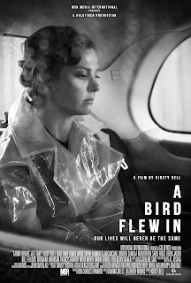 BW photo of lady in raincoat sitting in the back of a taxi cab