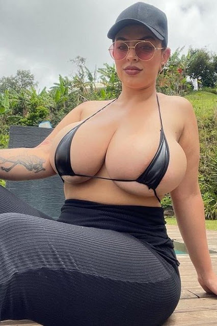 athletic woman with huge tits in tiny top