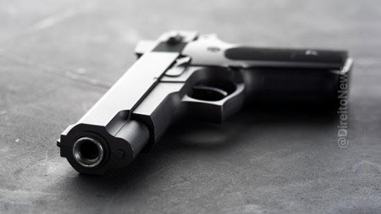 apreensao arma municao implica atipicidade conduta