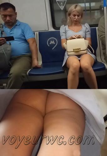 Upskirts 4631-4638 (Secretly taking an upskirt video of beautiful women on escalator)