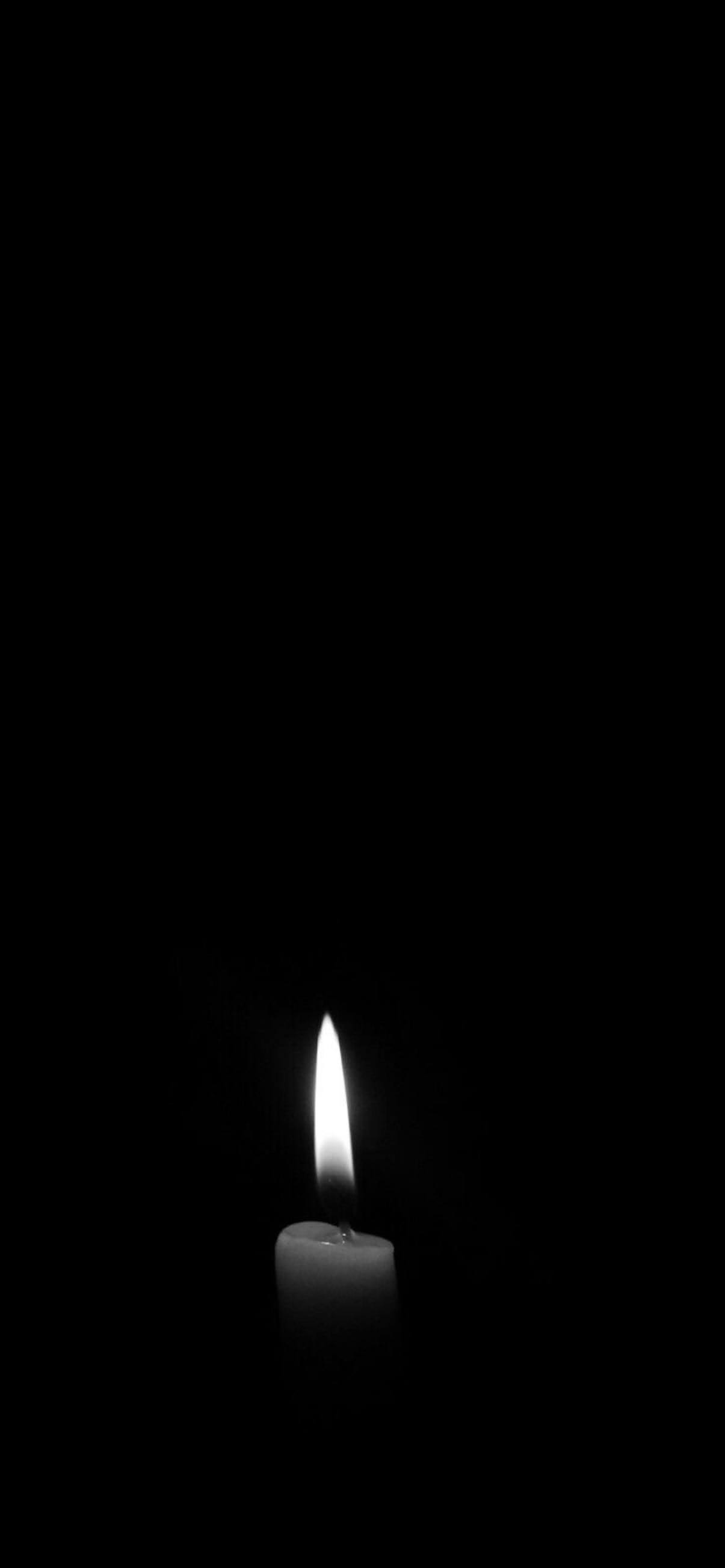Plain Black wallpaper for mobile with candle