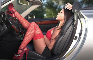 Jenny Babas posing for photo while sitting in car