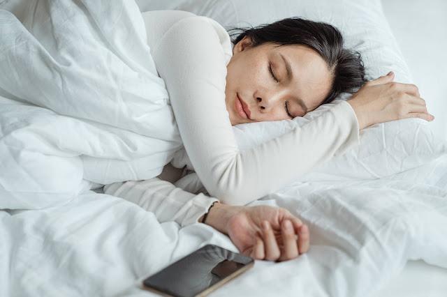 https://www.pexels.com/photo/woman-sleeping-in-bed-near-smartphone-4473864/