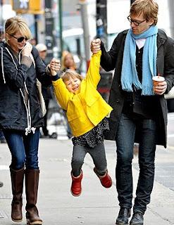 Picture of Dan Estabrook & his partner Megan Boone carrying their daughter